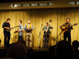 Sarah Mae & the 'Boys' with Jake Ashworth on banjo performing in Naples.